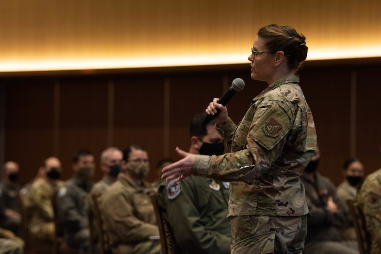 CMSgt Jessica L. Bender, the 18th Wing command chief master sergeant, speaks to Airmen during an all-call at Kadena Air Base, Japan, Jan 7, 2021.  The all-call discussed resiliency, COVID, and pressing issues concerning the base. (U.S. Air Force Photo by Airman 1st Class Stephen Pulter)