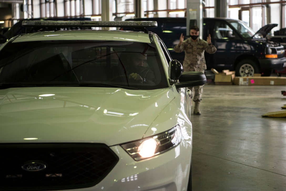 Challil Kessler, 86th Vehicle Readiness Squadron shop supervisor (left) and Senior Airman Jacob Croushore, 86 VRS vehicle mechanic, prepare to conduct a brake test on a 86th Security Forces Squadron vehicle at Ramstein Air Base.