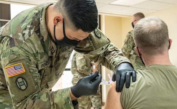 Members of the West Virginia National Guard participate in a COVID-19 vaccination clinic at Joint Forces Headquarters, Charleston, West Virginia, Jan. 13, 2021. West Virginia maintains one of the highest percentages of vaccine allocation use in the United States and is rapidly expanding capacity to inoculate the population.