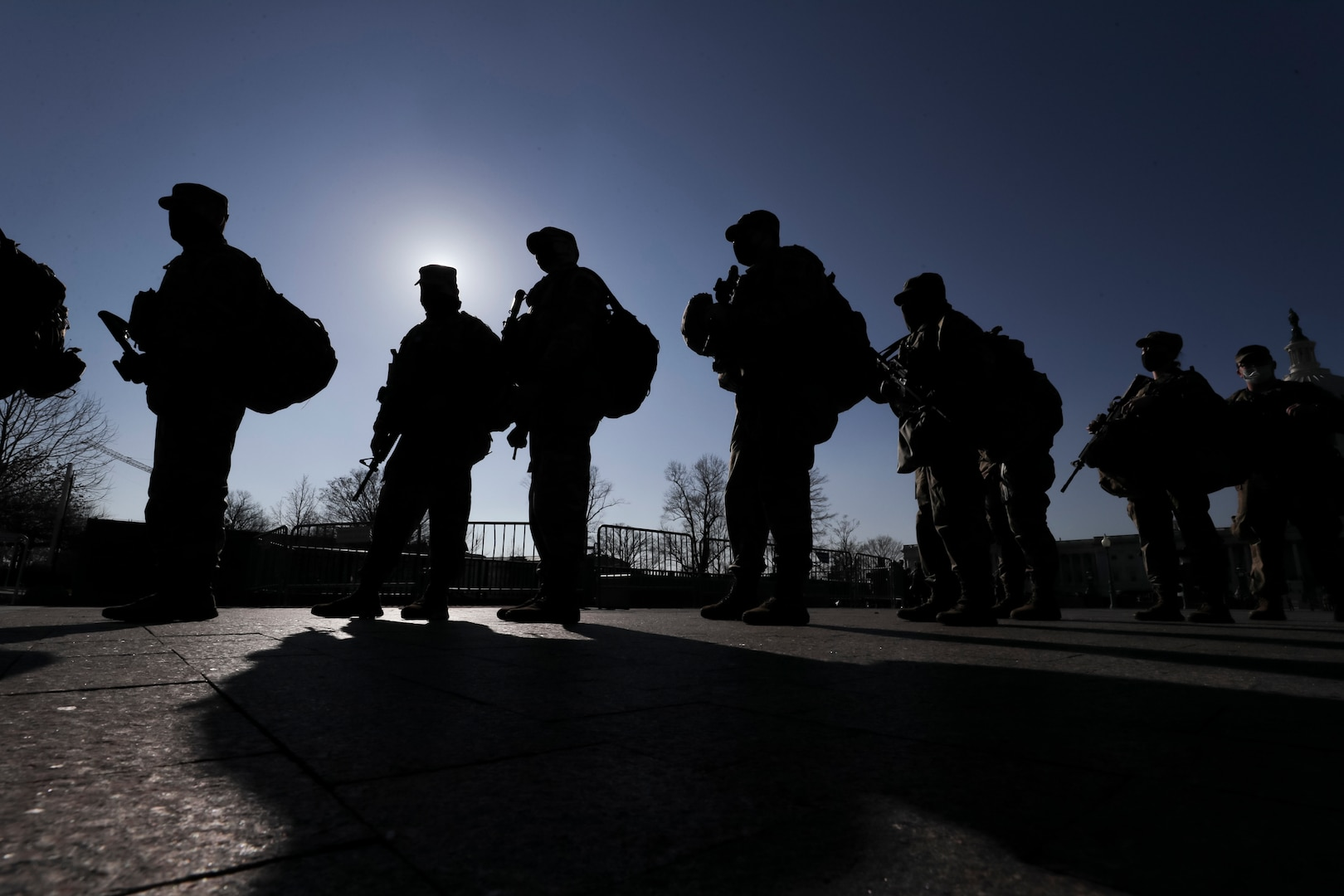 Airmen with the New Jersey Air National Guard's 108th Wing and 177th Fighter Wing finish their shift near the Capitol in Washington, D.C., Jan. 13, 2021. National Guard Soldiers and Airmen from several states have traveled to Washington to support to federal and district authorities for the Jan. 20 presidential inauguration.