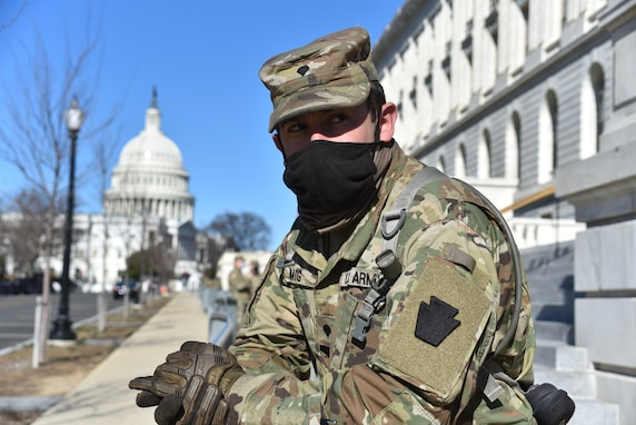 Spc. Kevin Romig,  2nd Squadron, 104th Cavalry Regiment, 56th Stryker Brigade Combat Team, Pennsylvania National Guard, from Reading, Pa., helps maintain a security perimeter around the U.S. Capitol in Washington, D.C., on Jan. 10, 2021. National Guard Soldiers and Airmen from several states have traveled to Washington to provide support to federal and district authorities leading up to the event.  (U.S. Air National Guard Photo by Master Sgt. George Roach)