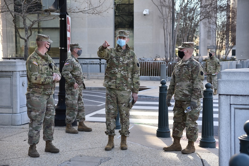 Col. Jon Farr, 56th Stryker Brigade Combat Team commander, inspects socially distanced security perimeters with Lt. Col. Adams, 2nd Squadron, 104th Cavalry Regiment, Pennsylvania Army National Guard in Washington, D.C., on Jan. 10, 2021.