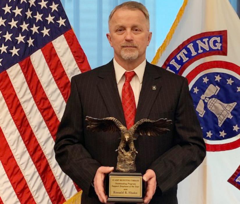 A man holds an award