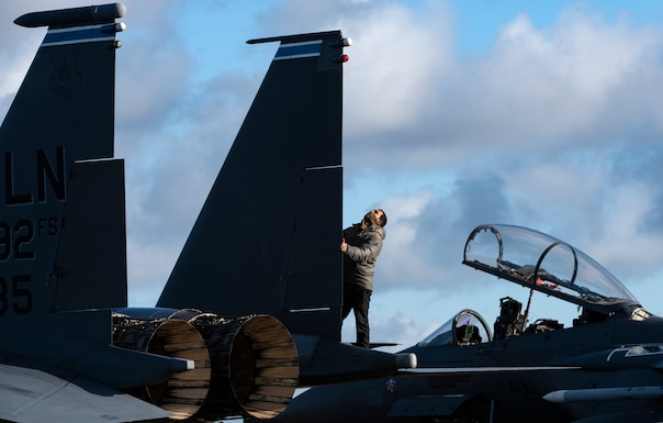 U.S. Air Force Staff Sgt. Miguel Talamantes, 492nd Aircraft Maintenance Unit crew chief, performs routine pre-flight checks on an F-15E Strike Eagle during Agile Combat Employment training at Royal Air Force Lakenheath, England, Jan. 12, 2021.  Exercising elements of ACE enables U.S. Air Forces in Europe to operate from locations with varying levels of capacity and support, ensuring Airmen and aircrews are postured to deliver lethal combat power across the spectrum of military operations. (U.S. Air Force photo by Airman 1st Class Jessi Monte)