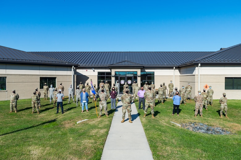 Personnel assigned to the 436th Communications Squadron stand in front of their building for a photo Nov. 9, 2020, at Dover Air Force Base, Delaware. Standing in the center is Maj. Peter Dell'Accio, 436th CS commander; to his left is Senior Master Sgt. Adam Jensen, 436th CS superintendent; and to his right is Master Sgt. Christopher Anderson, 436th CS first sergeant. The 436th CS plans, installs, operates and maintains $75 million in command, control, communications, computer and visual information systems for two C-5 airlift wings and the National Weather Service. Mission areas include classified and unclassified data networks, airfield navigation and landing equipment, air traffic control systems maintenance, airport surveillance and weather radar, telephone and wireless communications, public address systems, frequency management and base information management. (U.S. Air Force photo by Airman Cydney Lee)