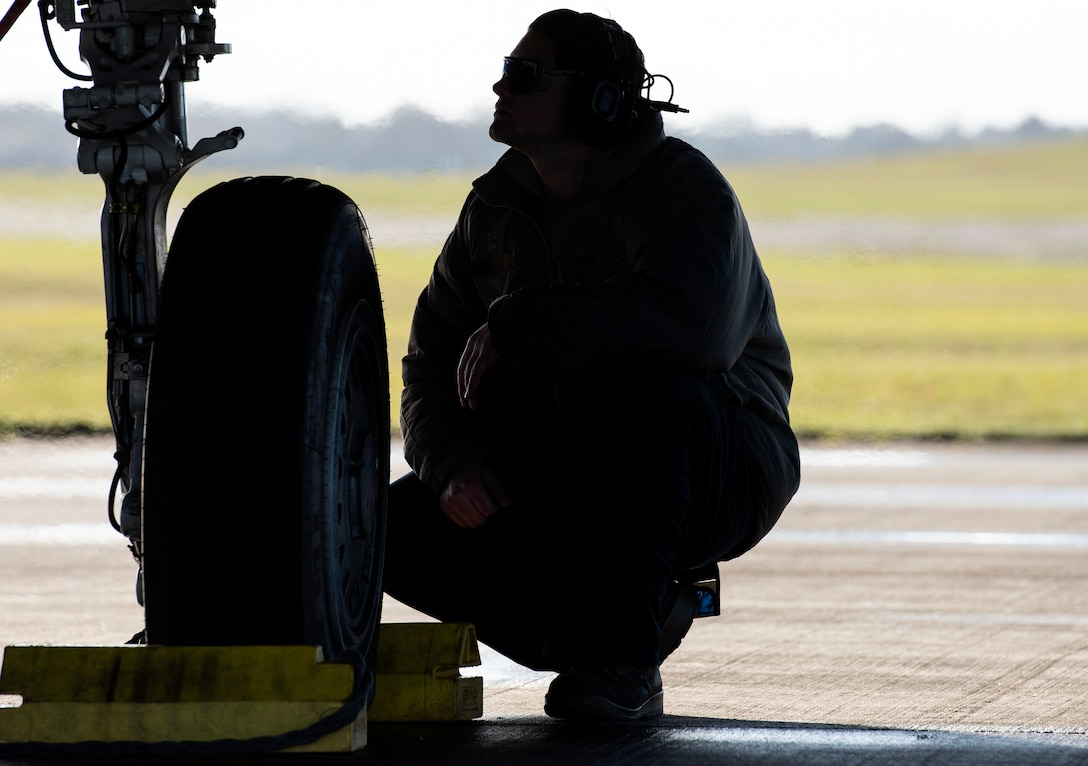 U.S. Air Force Senior Airman Joseph Robinson, 492nd Aircraft Maintenance Unit crew chief, performs post flight checks on an F-15E Strike eagle during Agile Combat Employment training at Royal Air Force Lakenheath, England, Jan. 12, 2021. Agile Combat Employment capabilities ensure U.S. Air Forces in Europe, along with allies and partners, are ready for potential last minute contingencies by allowing forces to operate from locations with varying levels of capacity and support. (U.S. Air Force photo by Airman 1st Class Jessi Monte)