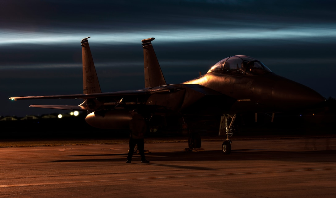 A U.S. Air Force Airman from the 48th Aircraft Maintenance Squadron performs pre-flight checks on an F-15E Strike Eagle during Agile Combat Employment training at Royal Air Force Lakenheath, England, Jan. 12, 2021. Agile Combat Employment capabilities ensure U.S. Air Forces in Europe, along with allies and partners, are ready for potential last minute contingencies by allowing forces to operate from locations with varying levels of capacity and support. (U.S. Air Force photo by Airman 1st Class Jessi Monte)