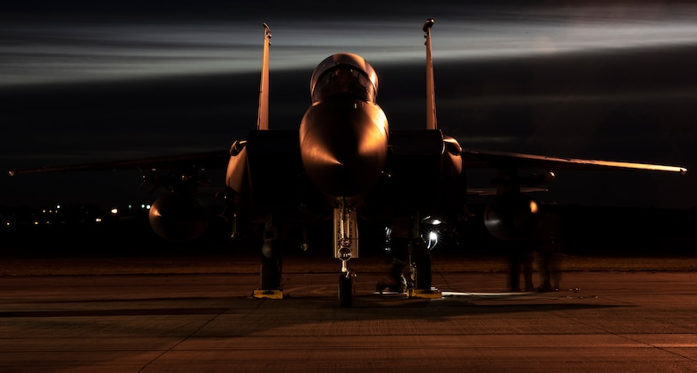 U.S. Air Force Airmen from the 48th Aircraft Maintenance Squadron perform pre-flight checks on an F-15E Strike Eagle during Agile Combat Employment training at Royal Air Force Lakenheath, England, Jan. 12, 2021. Exercising elements of ACE enables U.S. Air Forces in Europe to operate from locations with varying levels of capacity and support, ensuring Airmen and aircrews are postured to deliver lethal combat power across the spectrum of military operations. (U.S. Air Force photo by Airman 1st Class Jessi Monte)