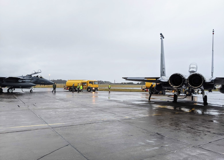 F-15E Strike Eagles assigned to the 492nd Fighter Squadron receive fuel during an Agile Combat Employment exercise at Royal Air Force Leuchars Airfield, Scotland, Jan. 11, 2021. Agile Combat Employment ensures U.S. Air Forces in Europe, along with allies and partners, are ready for potential last minute contingencies by allowing forces to operate from locations with varying levels of capacity and support. (Courtesy photo)