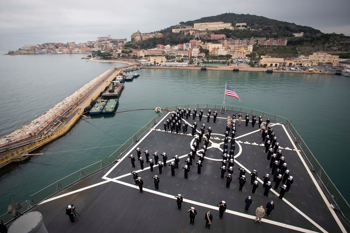120114-N-NO901-0054 GAETA, Italy (Jan. 14, 2021) The crew of U.S. Sixth Fleet command and control ship USS Mount Whitney (LCC 20) stands in formation during the ship's 50th anniversary celebration, Jan. 14, 2021, in Gaeta, Italy. U.S. Sixth Fleet, headquartered in Naples, Italy, conducts the full spectrum of joint and naval operations, often in concert with allied and interagency partners, in order to advance U.S. national interests, security and stability in Europe and Africa. (U.S. Navy photo by Hospital Corpsman 2nd Class Jared Kercell/ Released)
