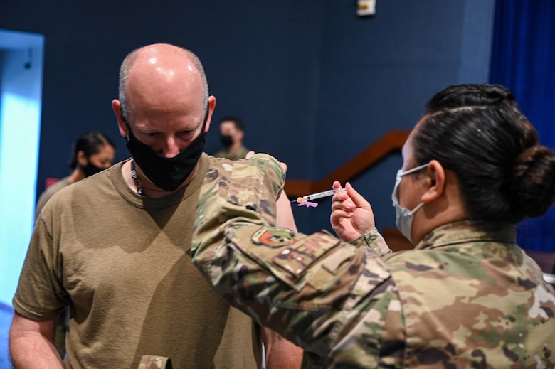 Brig. Gen. Stephen Purdy, 45th Space Wing Commander, recieves a COVID-19 vaccine at Patrick Space Force Base, Fla., Jan. 14, 2021. The 45th Medical Group administered the first round of the vaccine in accordance with the Department of Defense's COVID-19 vaccine distribution plan. (U.S. Space Force Photo By Airman First Class Thomas Sjoberg)