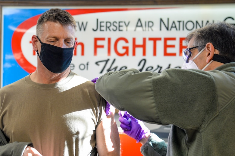 A photo of Colonel Bradford R. Everman receiving one of the first COVID-19 vaccines given at the 177th Fighter Wing.