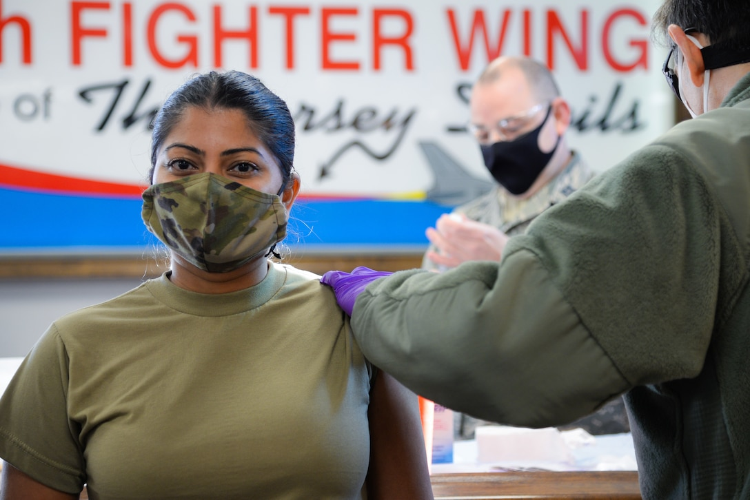 A photo of Senior Airman Roshni Patel receiving a COVID-19 vaccine.