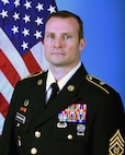 "US Army Official Photo CSM Patrick ""Gene"" Cunningham - with flag."