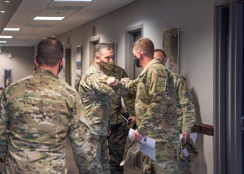 U.S. Army Gen. James H. Dickinson bumps elbows with a member of Delta 3 leadership