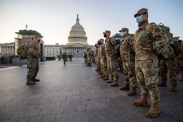 New Jersey National Guard Soldiers and Airmen from 1st Battalion, 114th Infantry Regiment, 508th Military Police Company, 108th Wing, and 177th Fighter Wing arrive near the Capitol to set up security positions in Washington, D.C., Jan. 12, 2021. National Guard Soldiers and Airmen from several states have traveled to Washington to provide support to federal and district authorities leading up to the 59th Presidential Inauguration.