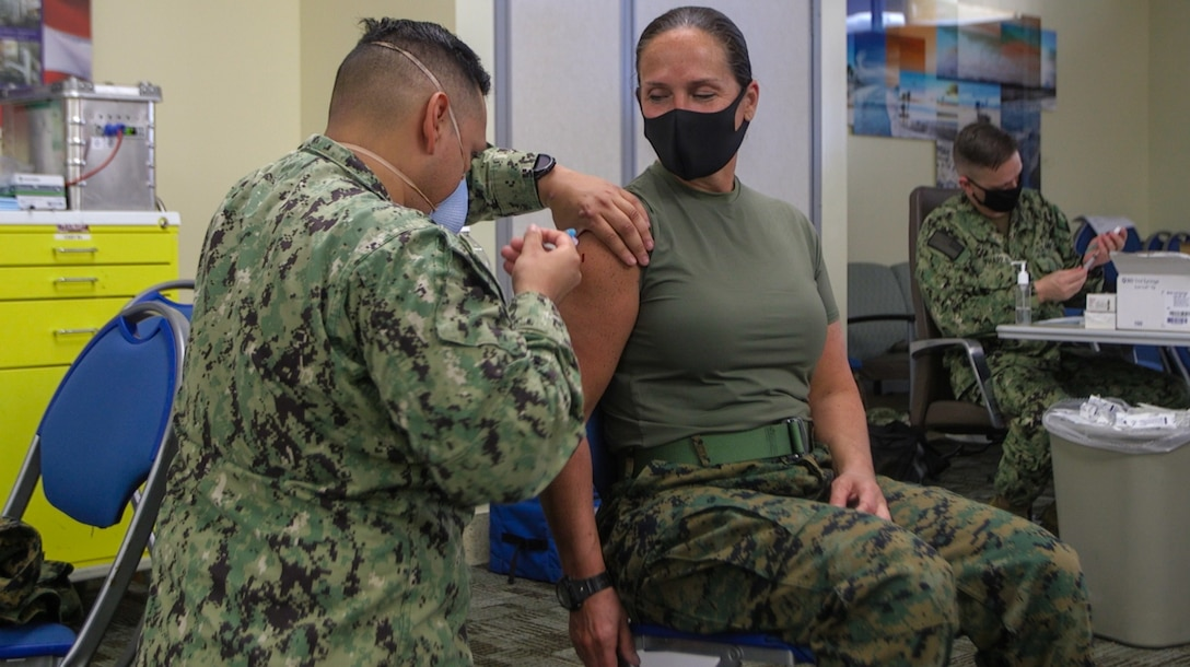 """U.S. Marine Corps Brig. Gen. Bobbi Shea, commanding general, 1st Marine Logistics Group, along with other members of the 1st MLG command team, receive the COVID-19 vaccine at the naval hospital on Marine Corps Base Camp Pendleton, California, Jan. 13, 2021. While the COVID-19 vaccine is voluntary, all eligible Marine Corps personnel and beneficiaries are highly encouraged to be vaccinated to protect their health and their community. """"I got my vaccine today because, along with wearing a mask, washing your hands, and social distancing, receiving the vaccine when available adds another layer of protection to ensure 1st MLG is ready, trained and capable, in service to our Nation"""" said Brig. Gen. Bobbi Shea."""