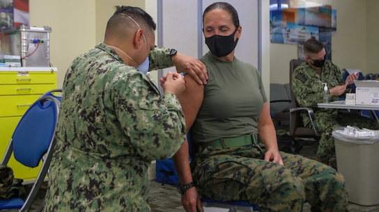 "U.S. Marine Corps Brig. Gen. Bobbi Shea, commanding general, 1st Marine Logistics Group, along with other members of the 1st MLG command team, receive the COVID-19 vaccine at the naval hospital on Marine Corps Base Camp Pendleton, California, Jan. 13, 2021. While the COVID-19 vaccine is voluntary, all eligible Marine Corps personnel and beneficiaries are highly encouraged to be vaccinated to protect their health and their community. ""I got my vaccine today because, along with wearing a mask, washing your hands, and social distancing, receiving the vaccine when available adds another layer of protection to ensure 1st MLG is ready, trained and capable, in service to our Nation"" said Brig. Gen. Bobbi Shea."