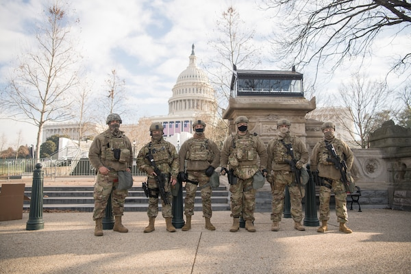 Virginia National Guard Airmen assigned to the 192nd Security Forces Squadron, 192nd Mission Support Group, 192nd Wing stand guard on the grounds of the U.S. Capitol, Jan. 13, 2021, in Washington, D.C.