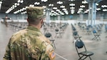 U.S. Army Spc. Anthony Randazzo, wheeled vehicle mechanic assigned to Company H 427 Battalion Support Brigade, waits for his cue during a mission rehearsal for mass COVID-19 vaccinations in support of the New York State Department of Health at the Javits Convention Center in New York, Jan. 10, 2021. The New York National Guard has more than 350 members deployed to the vaccination site.