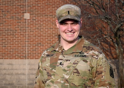 FORT DRUM, N.Y. – 1st Lt. Thomas Vincent, an infantry officer with 2nd Battalion, 22nd Infantry Regiment, 1st Brigade Combat Team, 10th Mountain Division (Light Infantry), stands in front of his company headquarters on Fort Drum, N.Y. Dec. 11, 2020.  Following a severe car accident resulting in multiple injuries, Vincent spent nearly a year in recovery assigned to the Fort Drum Soldier Recovery Unit before overcoming his injuries and returning to duty in late November 2020.