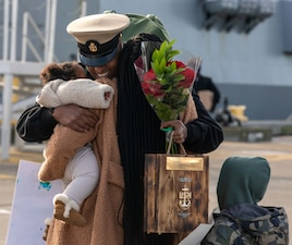 Chief Gas Turbine System Technician (Mechanical) Kirubel Weldeyes assigned to Arleigh Burke-class guided-missile destroyer USS Ralph Johnson (DDG 114) reunites with his family in Naval Station Everett.