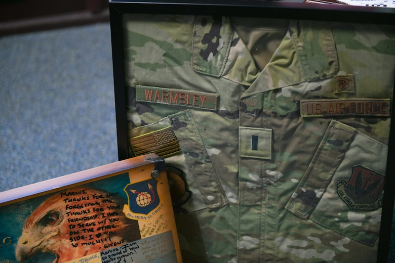A uniform in a shadow box, and other mementos
