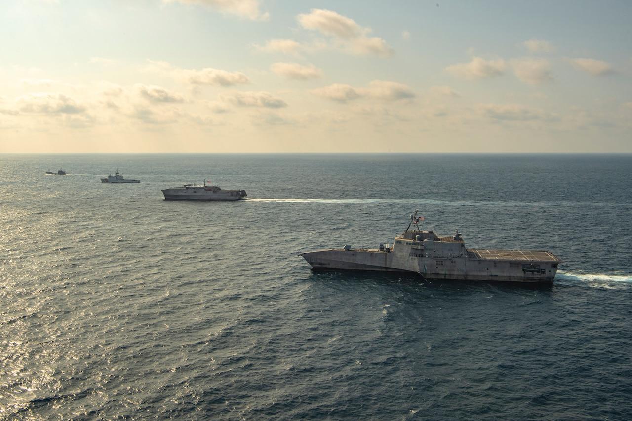 Four ships sail the sea.