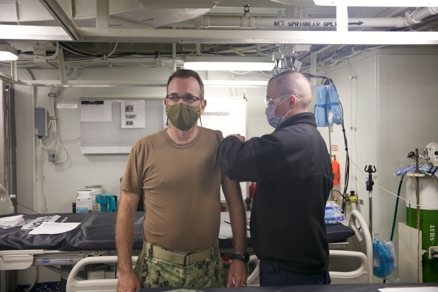 Rear Adm. Robert Katz, commander, Expeditionary Strike Group (ESG 2), receives the COVID-19 vaccination aboard the amphibious transport dock ship USS San Antonio (LPD 17), Jan. 11, 2021.