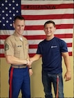 U.S. Marine Staff Sgt. Jonathon Sweet, the staff noncommissioned officer in charge of Recruiting Substation Northern Michigan, congratulates a newly enlisted Marine Corps poolee on his enlistment, Nov. 11, 2018.