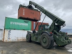 A person undergoes training on a Rough Terrain Container Handler at DLA Disposition Services site at Joint Base Lewis McChord, Washington. The RTCH is a new addition to the site.