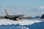 A U.S. Air Force F-16 Fighting Falcon, assigned to the 13th Fighter Squadron, taxis towards the runway at Misawa Air Base, Japan, Jan. 11, 2021. Despite the harsh weather conditions, the 35th Fighter Wing continues executing its mission of projecting combat air power and defending.
