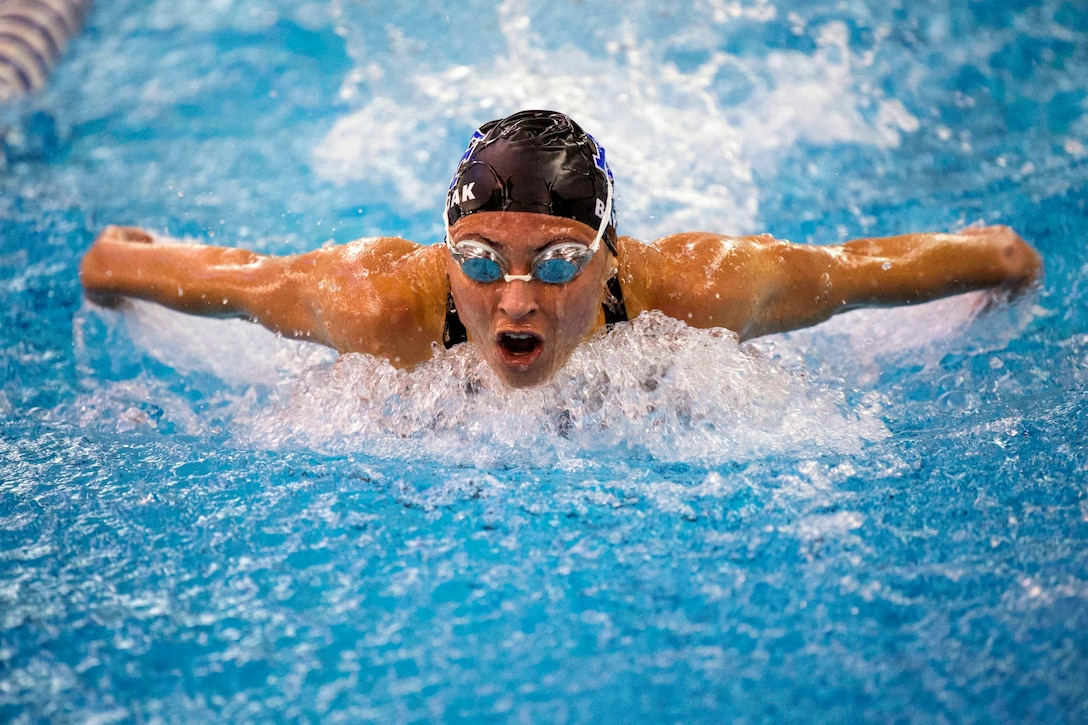 A cadet performs the butterfly stroke.