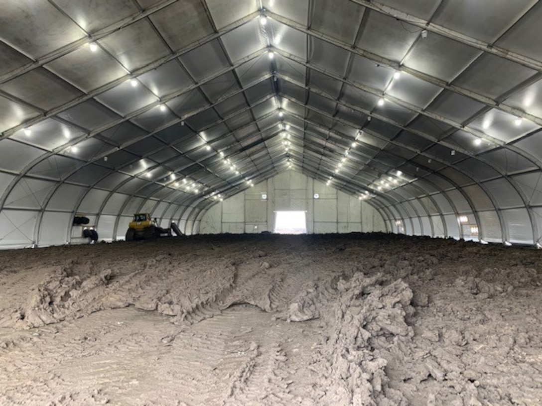 Eight heated tents to condition cohesive material so it can be placed along the levee setback alignment are being used on the L-536 levee system just south of Rock Port, Mo..