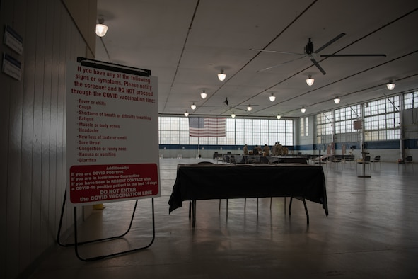 A screening desk was set up in the honor guard hangar January 11, 2020, on Maxwell Air Force Base, Alabama. Airmen with the 42nd Medical Group converted the hangar into an off-site clinic, where they will begin administering the COVID-19 vaccine on January 16.