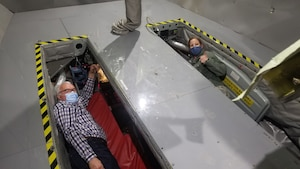 Two people lay in plane
