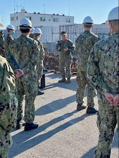 ROTA, Spain (Jan. 15, 2021) - Chief of Naval Operations (CNO) Adm. Mike Gilday and Master Chief Petty Officer of the Navy (MCPON) Russ Smith address the crews of the Arleigh Burke-class guided-missile destroyers USS Roosevelt (DDG 80) and USS Ross (DDG 71) pier side. Gilday and Smith are visiting Rota to highlight the importance of warfighting and readiness to Sailors in the region. (U.S. Navy photo by Cmdr. Nate Christensen/Released)