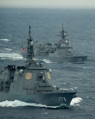 The Japan Maritime Self-Defense Force Kongo-class guided-missile destroyer JS Kongo (DDG 173), front, and Asahi-class destroyer JS Asahi (DD 119) transit the Pacific Ocean Jan. 15, 2021 with the Theodore Roosevelt Carrier Strike Group.