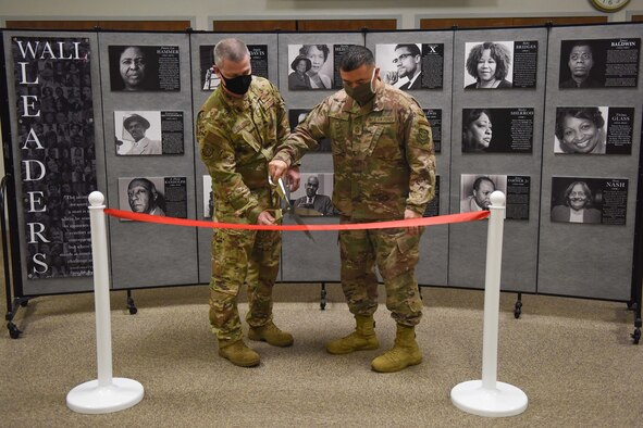 Col. Brian Collins, 62nd Airlift Wing (AW) vice commander (left), and Chief Master Sgt. Joseph Arce, 62nd AW command chief, cut a ribbon during the grand opening ceremony for the Martin Luther King Jr. and Civil Rights Movement Pop-Up Museum at Joint Base Lewis-McChord, Wash., Jan. 12, 2021. The museum will be open until Jan. 22, 2021, in honor of MLK Day. (U.S. Air Force photo by Airman 1st Class Callie Norton)