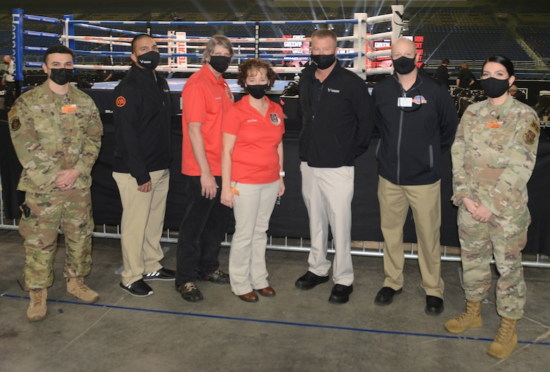Col. Lisa Craig (middle top photo), AFRS deputy commander, was able to take in her first event since coming to Air Force Recruiting Service, as she toured the activation of the WBA Super World Super Middleweight Championship fight at the Alamodome in San Antonio, Dec. 19, 2020.