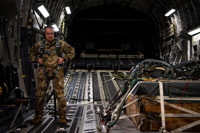 An Airman from the 791st Airlift Squadron adjusts his harness on a C-17 Globemaster III above North Field North, S.C., Jan. 15, 2021.