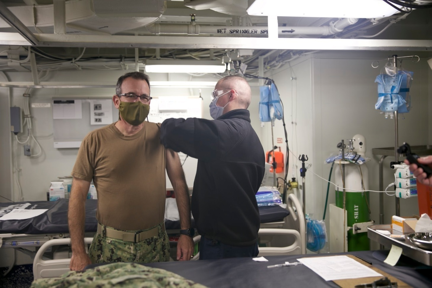 Rear Adm. Robert Katz, commander, Expeditionary Strike Group (ESG 2), receives the COVID-19 vaccination aboard the amphibious transport dock ship USS San Antonio (LPD 17), Jan. 11, 2021