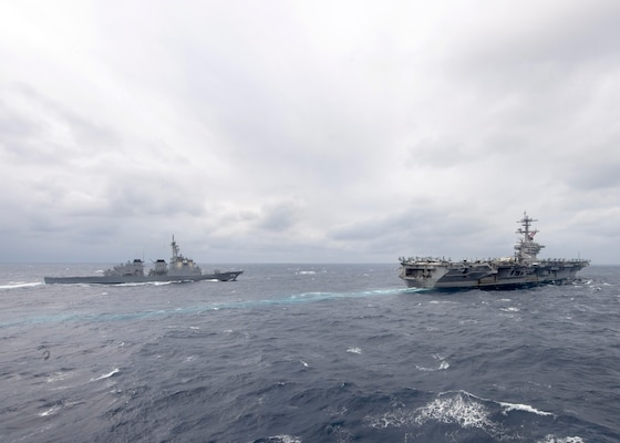 The aircraft carrier USS Theodore Roosevelt (CVN 71), right, and the Japan Maritime Self-Defense Force Kongo-class guided-missile destroyer JS Kongo (DDG 173) transit the Pacific Ocean on Jan. 15, 2021.