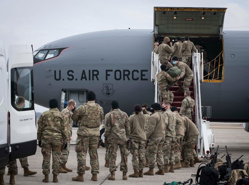 Members of the Tennessee National Guard offload equipment from a KC-135 Stratotanker, assigned to the 134th Air Refueling Wing, Tennessee Air National Guard, upon arrival to Joint Base Andrews, Md., Jan. 15, 2021. National Guard Soldiers and Airmen from several states have traveled to Washington, D.C., to support federal and D.C. authorities leading up to the 59th presidential inauguration.