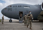 Members of the North Carolina National Guard deboard a C-17 Globemaster III, assigned to the 145th Airlift Wing, North Carolina Air National Guard, upon arrival to Joint Base Andrews, Md., outside Washington, D.C., on Jan. 15, 2021. National Guard Soldiers and Airmen are supporting federal and district authorities for the 59th presidential inauguration.