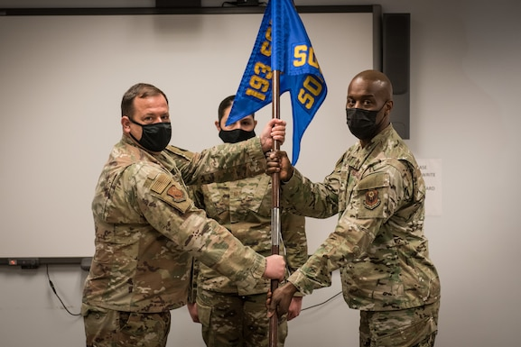 Lt. Col. Marvin Laing, right, receives the 193rd Special Operations Maintenance Squadron guidon from Col. Eric McKissick during an assumption of command ceremony,