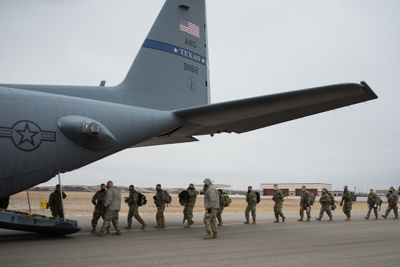 North Dakota National Guard Soldiers from the 816th Military Police Company, Bismarck N.D., file into a C-130H2 aircraft assigned to the 136th Airlift Wing out of Fort Worth, Texas, Jan. 15, 2021. The Citizen-Soldiers departed for Washington, D.C., in support of the 59th presidential inauguration.