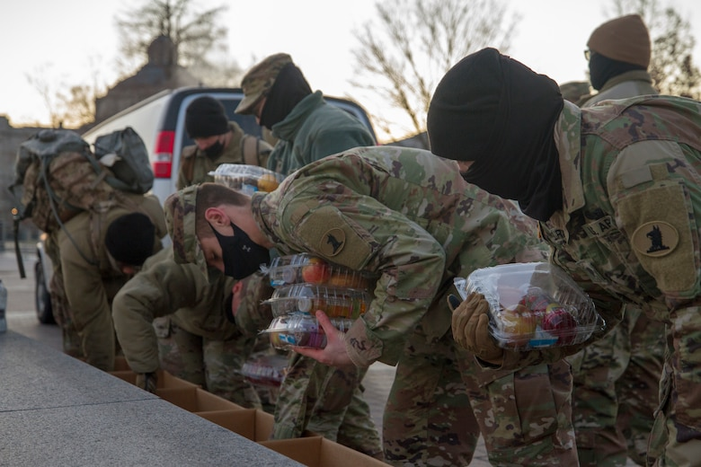 Soldiers and Airmen with the Delaware National Guard grab breakfast boxes while on duty near the U.S. Capitol, Jan. 12, 2021. National Guard officials are stressing that the Soldiers and Airmen from all 50 states, three territories and Washington, D.C., are receiving adequate food and lodging as they continue to support federal and local authorities leading up to the 59th presidential inauguration.