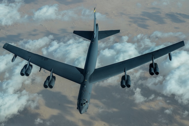 A U.S. Air Force B-52 Stratofortress assigned to the 5th Bomb Wing departs after receiving fuel from a KC-10 Extender assigned to the 908th Expeditionary Air Refueling Squadron during a Bomber Task Force (BTF) mission over the U.S. Central Command area of responsibility, Jan. 17, 2021. BTF missions or deployments showcase the U.S. Air Force's ability to rapidly and effectively support missions around the globe and seamlessly integrate into operations. (U.S. Air Force photo by Senior Airman Aaron Larue Guerrisky)