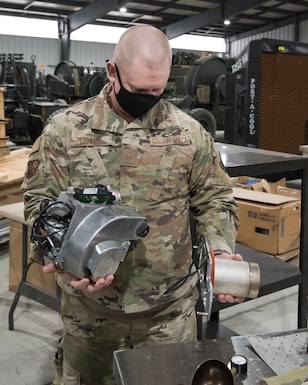 Tech. Sgt. Michael Lengle preps a burner to load onto a truck while preparing to deploy to the Capitol region in support of service members in the D.C. area for the 59th Presidential Inauguration